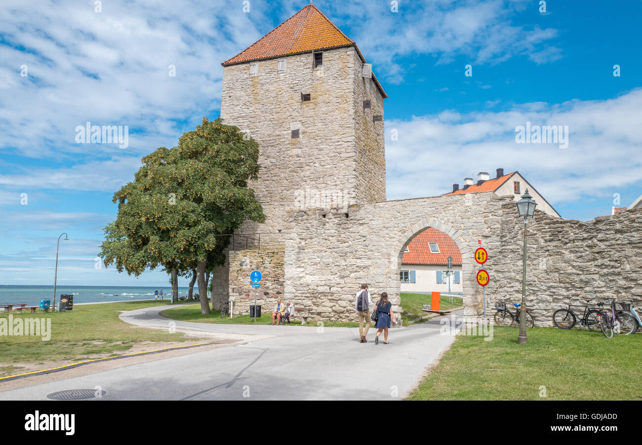 The city wall and the Gunpowder tower of Historic Hanse town Visby on Swedish Baltic sea island Gotland - Stock Image