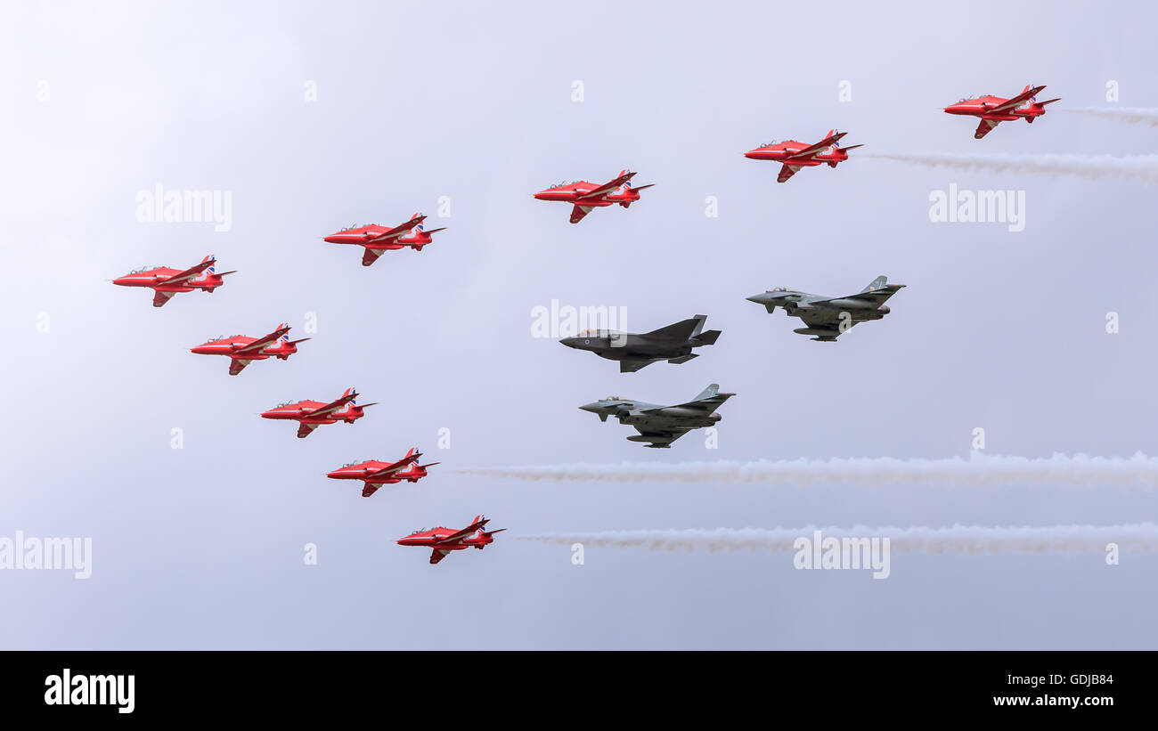 Red arrows Typhoons and Joint Strike Fighter F35 in formation - Stock Image