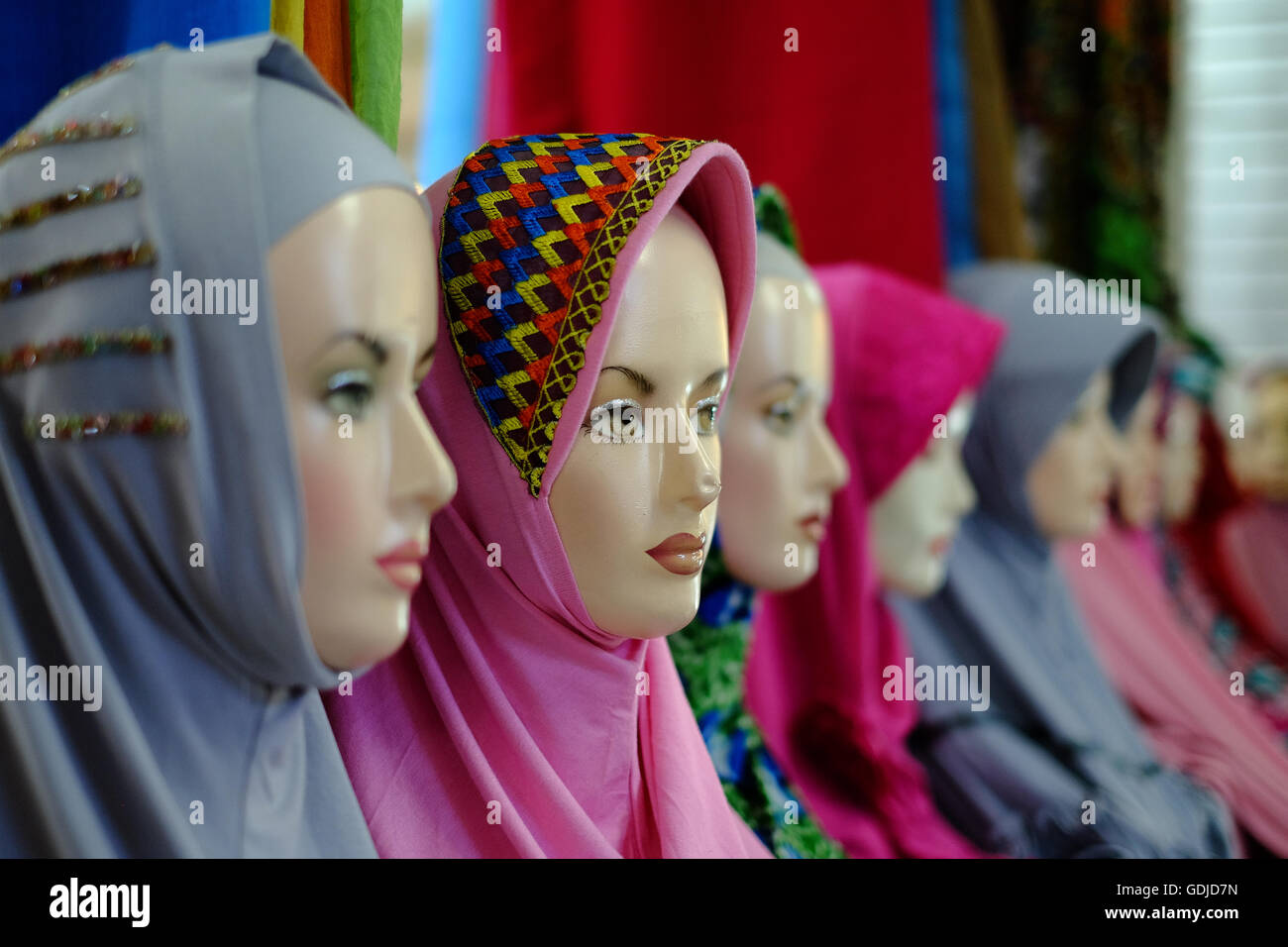 Mannequins showing the latest in hijab head scarf fashion, Yogyakarta, Indonesia - Stock Image