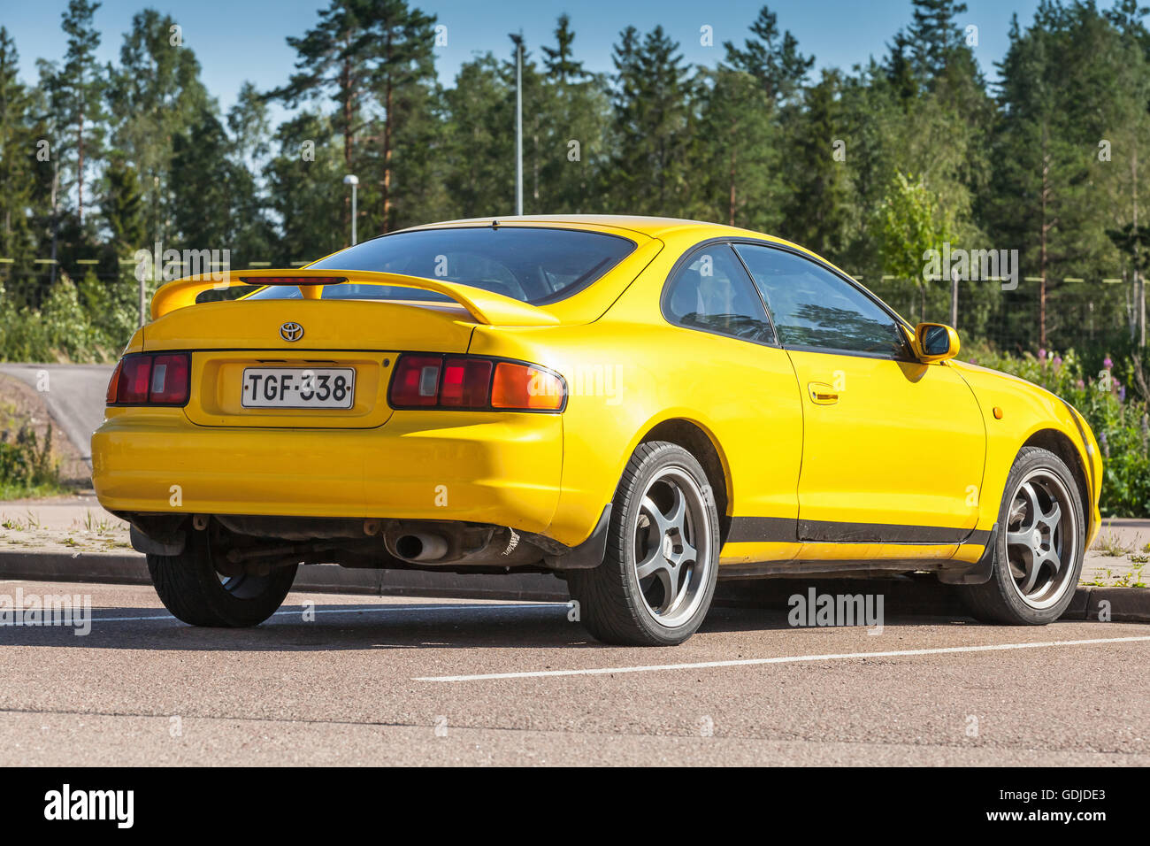 Kotka, Finland - July 16, 2016: Bright Yellow Facelift Toyota Celica GT liftback T200 model of 1994-1999, rear view Stock Photo