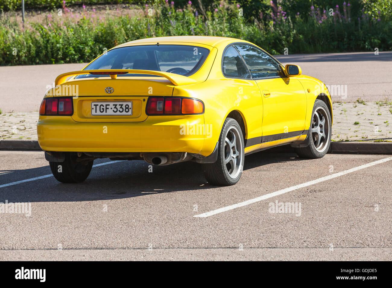 Kotka, Finland - July 16, 2016: Bright Yellow Facelift Toyota Celica GT liftback T200 model of 1994-1999, closeup Stock Photo