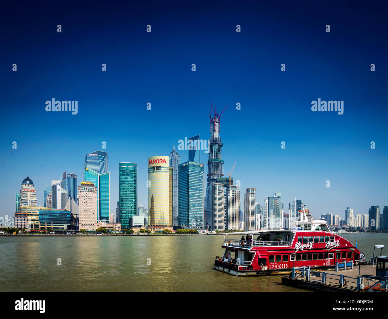 shanghai pudong city skyline and local river ferry boat in china - Stock Image