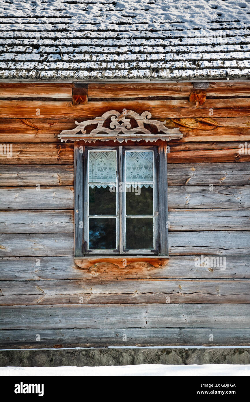 Window frame of a wooden log cabin Stock Photo
