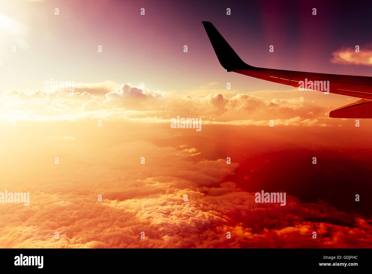 Flight above red clouds Stock Photo