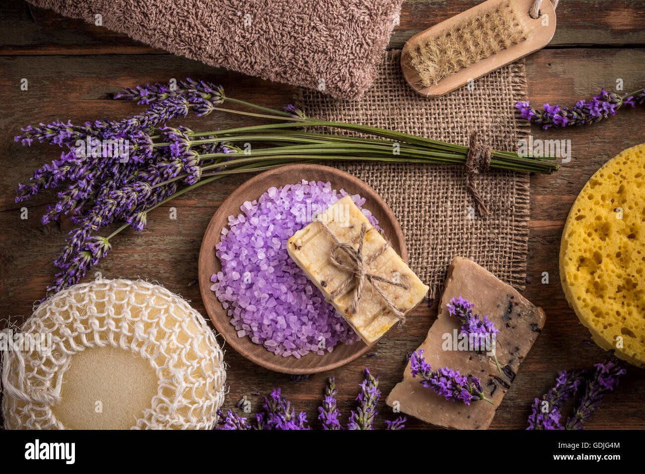 Natural soap, lavender and salt on a wooden board - Stock Image