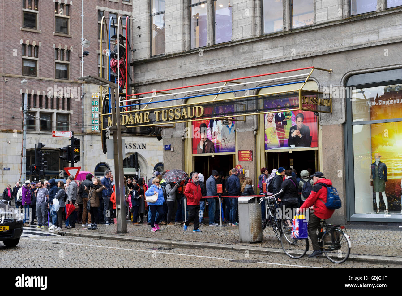 People queuing outside the famous Madame Tussaud in Amsterdam, Holland, Netherdalnds. - Stock Image