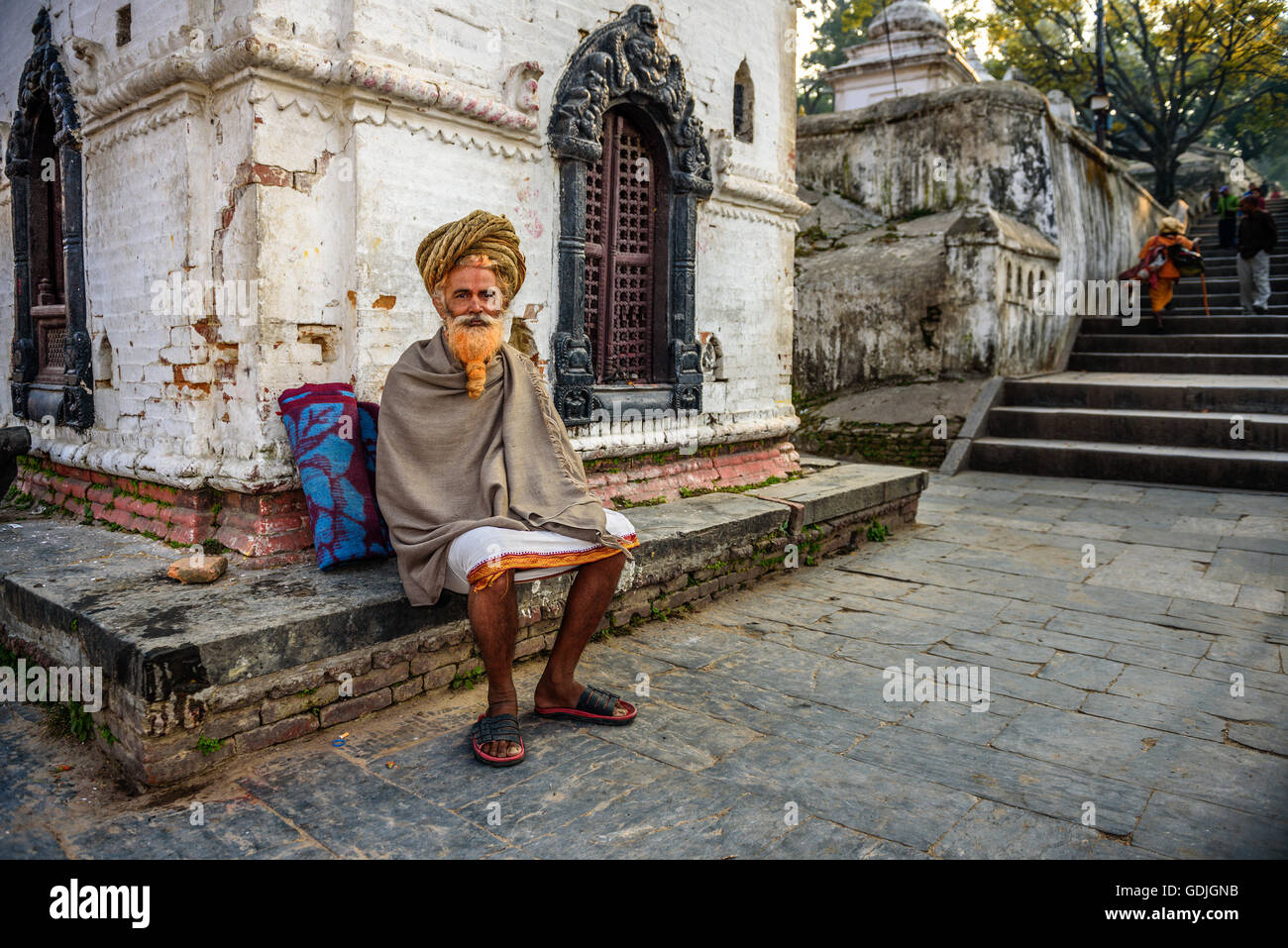 Wandering  sadhu baba (holy man) with traditional long hair in ancient Pashupatinath Temple - Stock Image