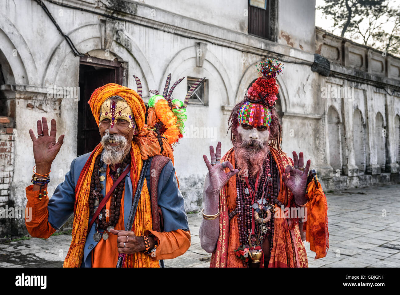 Wandering  Shaiva sadhus (holy men) with traditional body painting in ancient Pashupatinath Temple - Stock Image