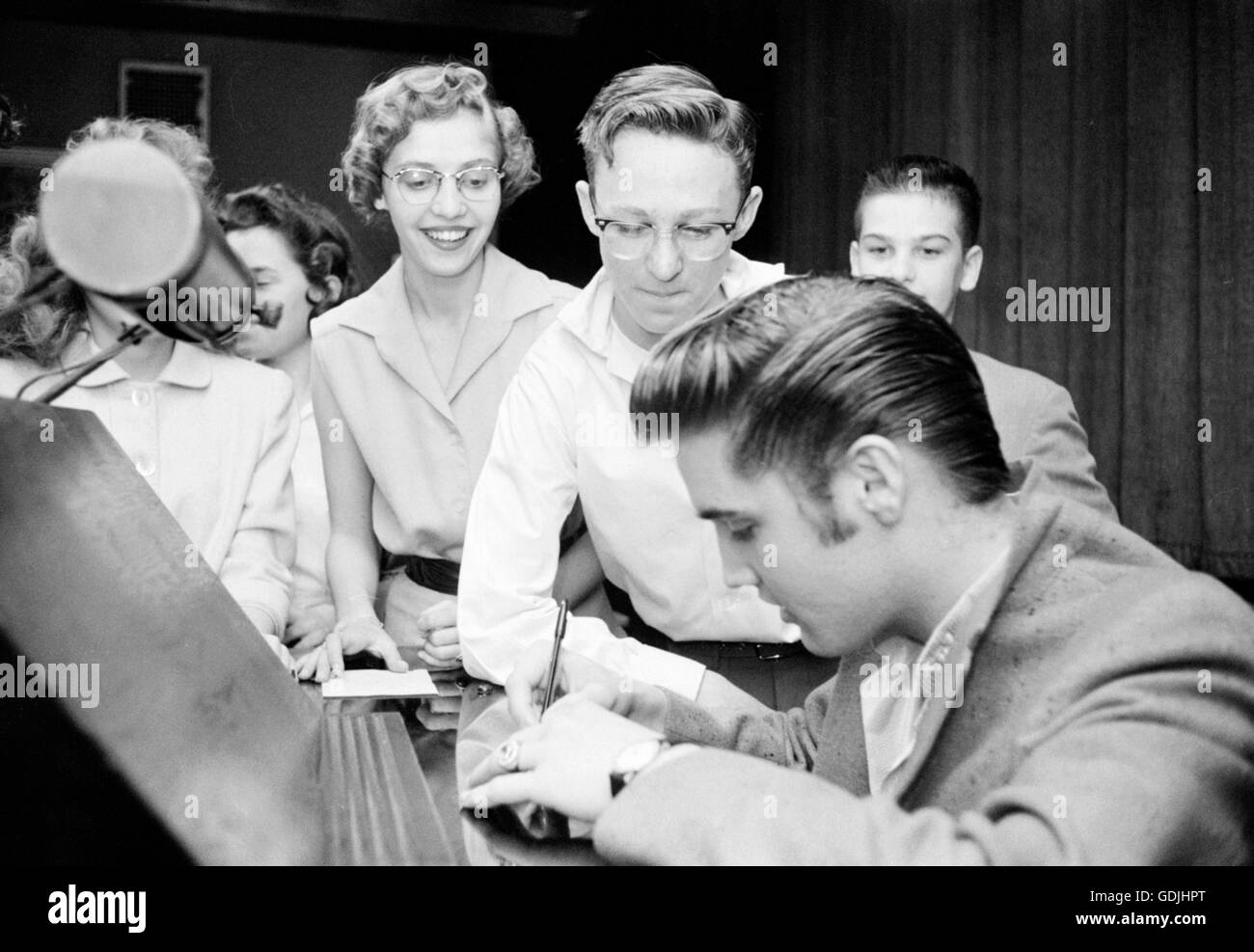 Elvis Presley meets with fans and signs autographs at the Fox Theater in Detroit, Michigan, May 25, 1956. - Stock Image