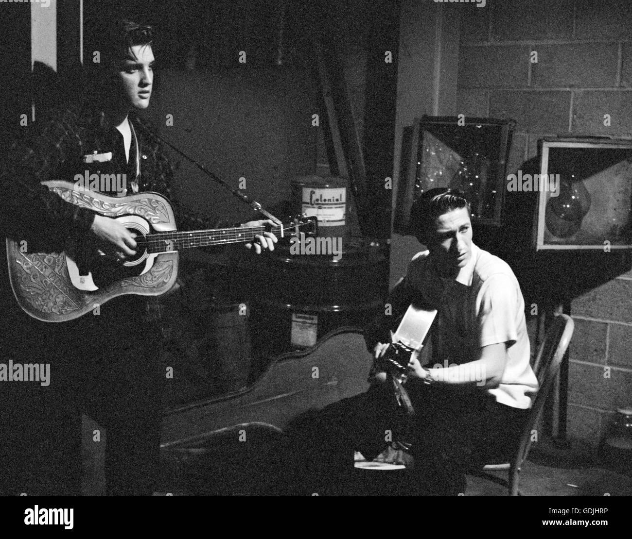Elvis Presley and Scotty Moore, between performances, backstage at the University of Dayton Fieldhouse, May 27, Stock Photo
