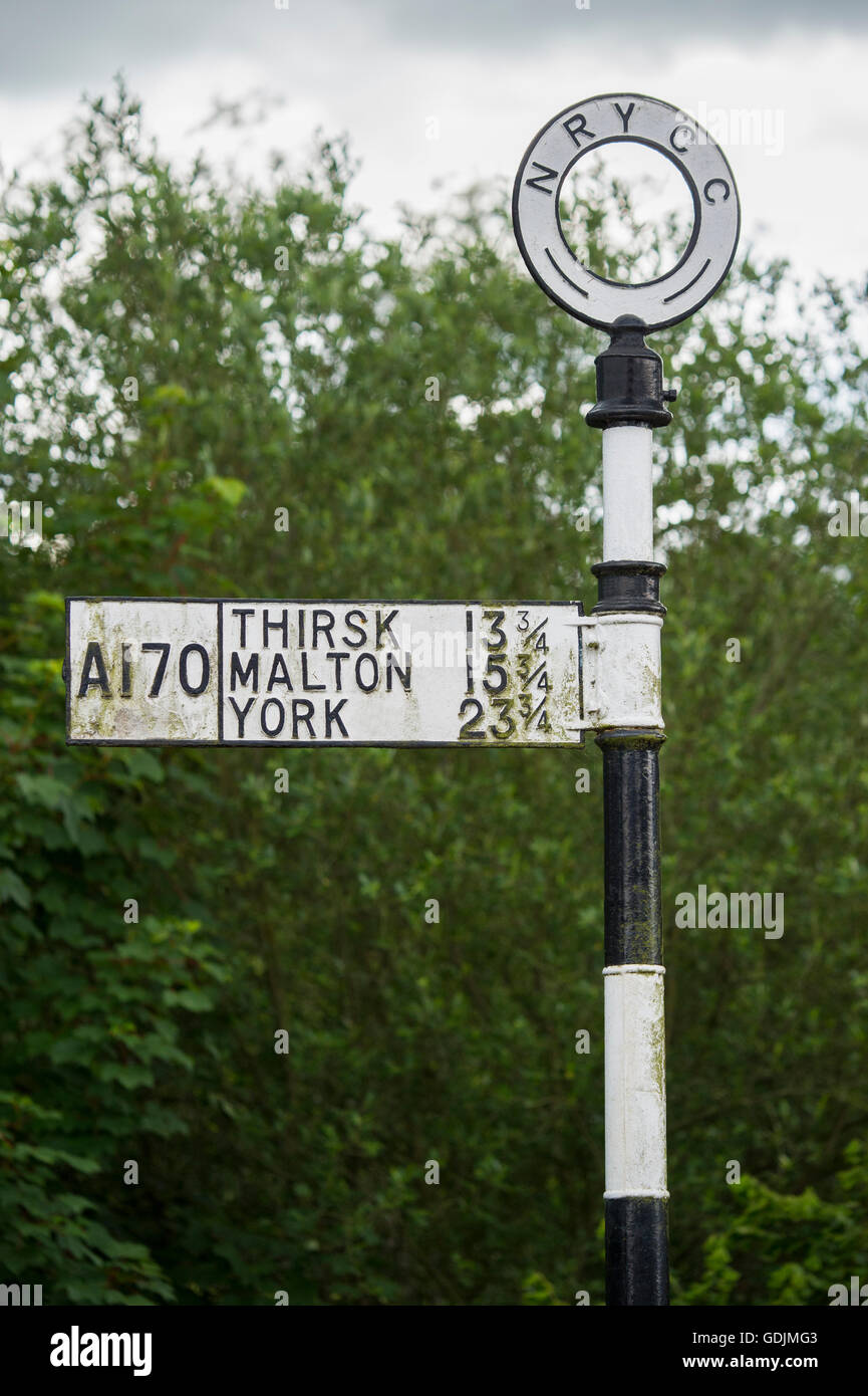 Helmsley, North Yorkshire - traditional cast iron sign post on the A170, pointing travelers in the right direction. - Stock Image