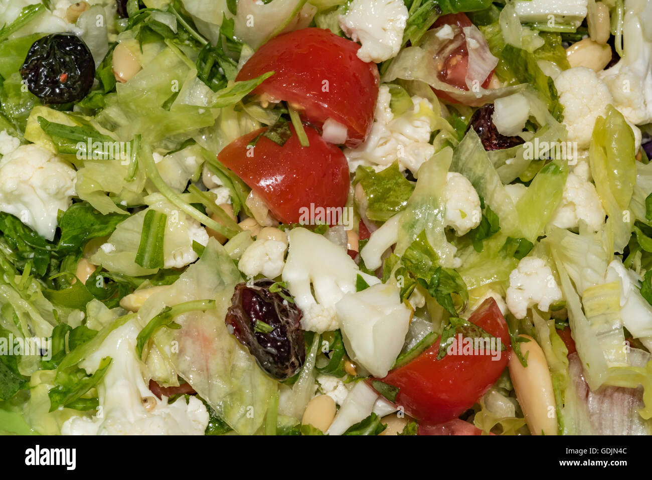 Green salad with oil droplets - Stock Image