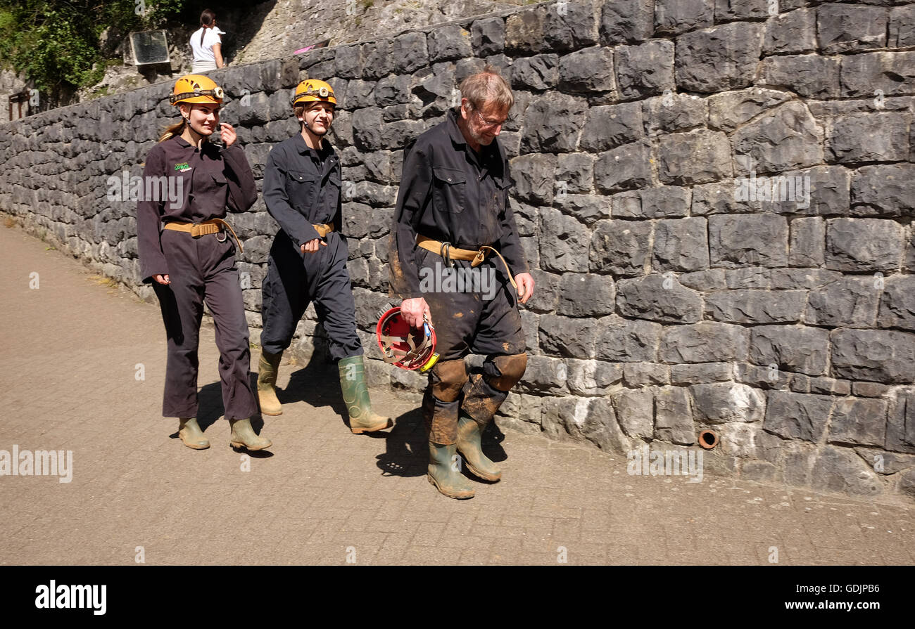 A group of tourists ready to explore the caves in Cheddar gorge and village Somerset. 17th July 2016 - Stock Image
