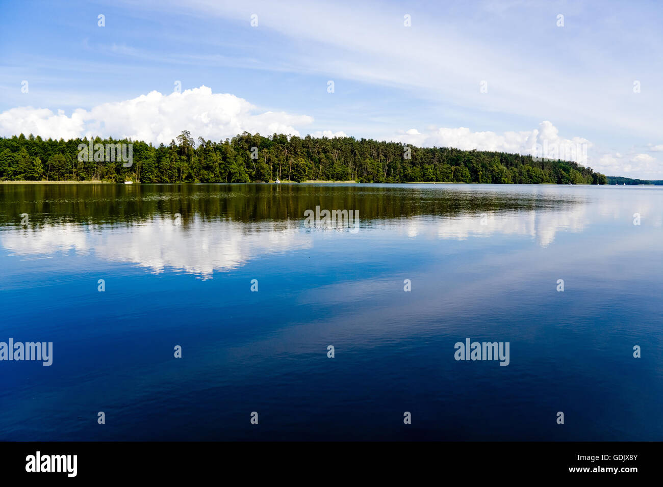 Blue lake surface, sky reflection in the water Stock Photo
