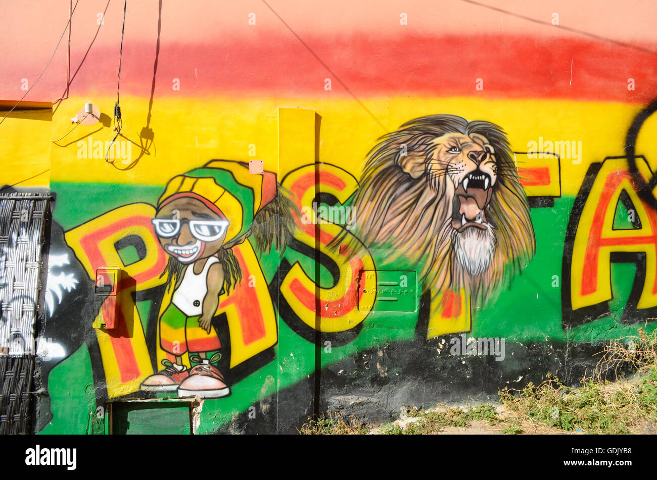 Reggae Street art drawn on a wall on the beach in Taghazout village ...