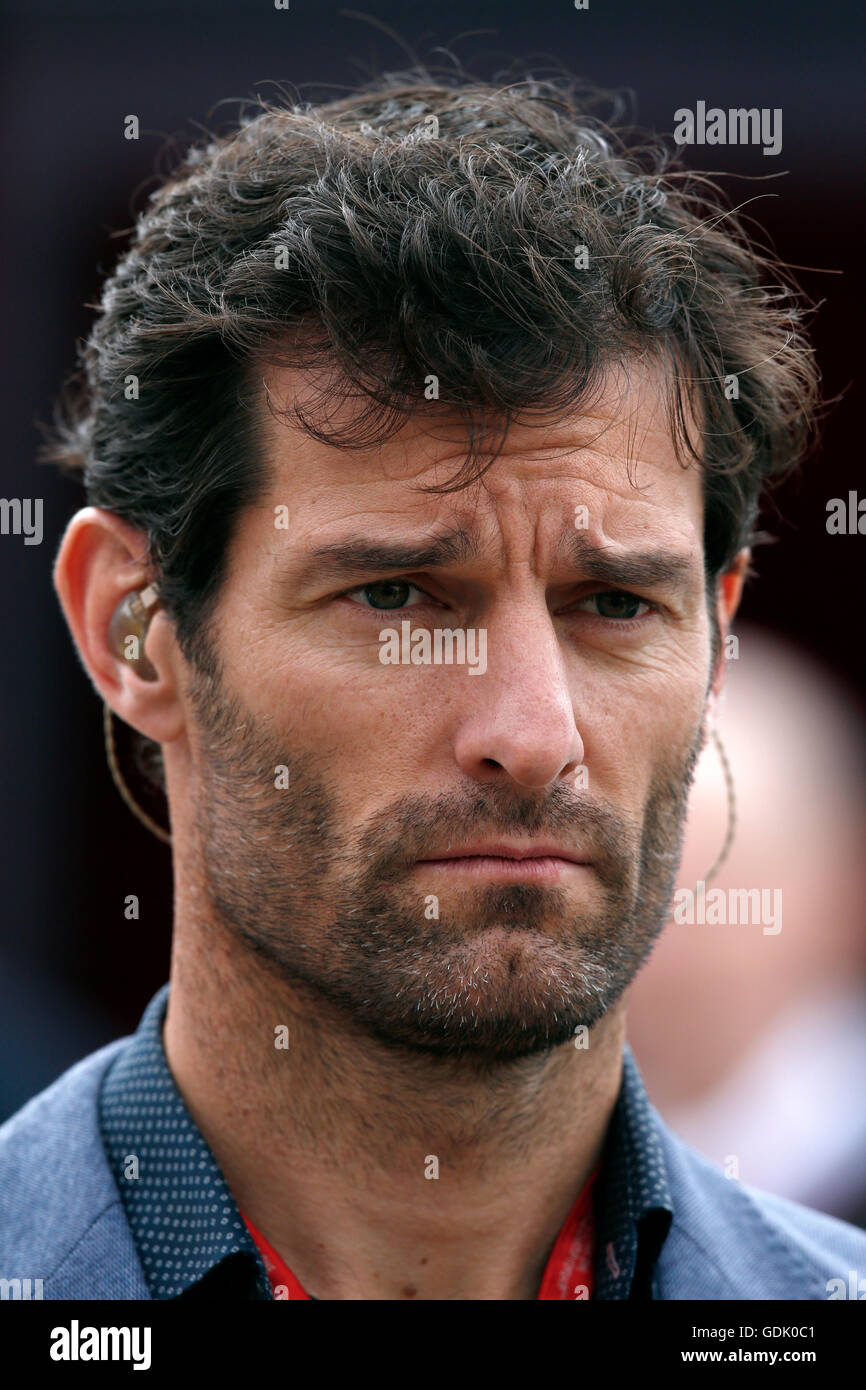 Racing driver Mark Webber presents Channel 4 television coverage of the Formula One race at Silverstone - Stock Image
