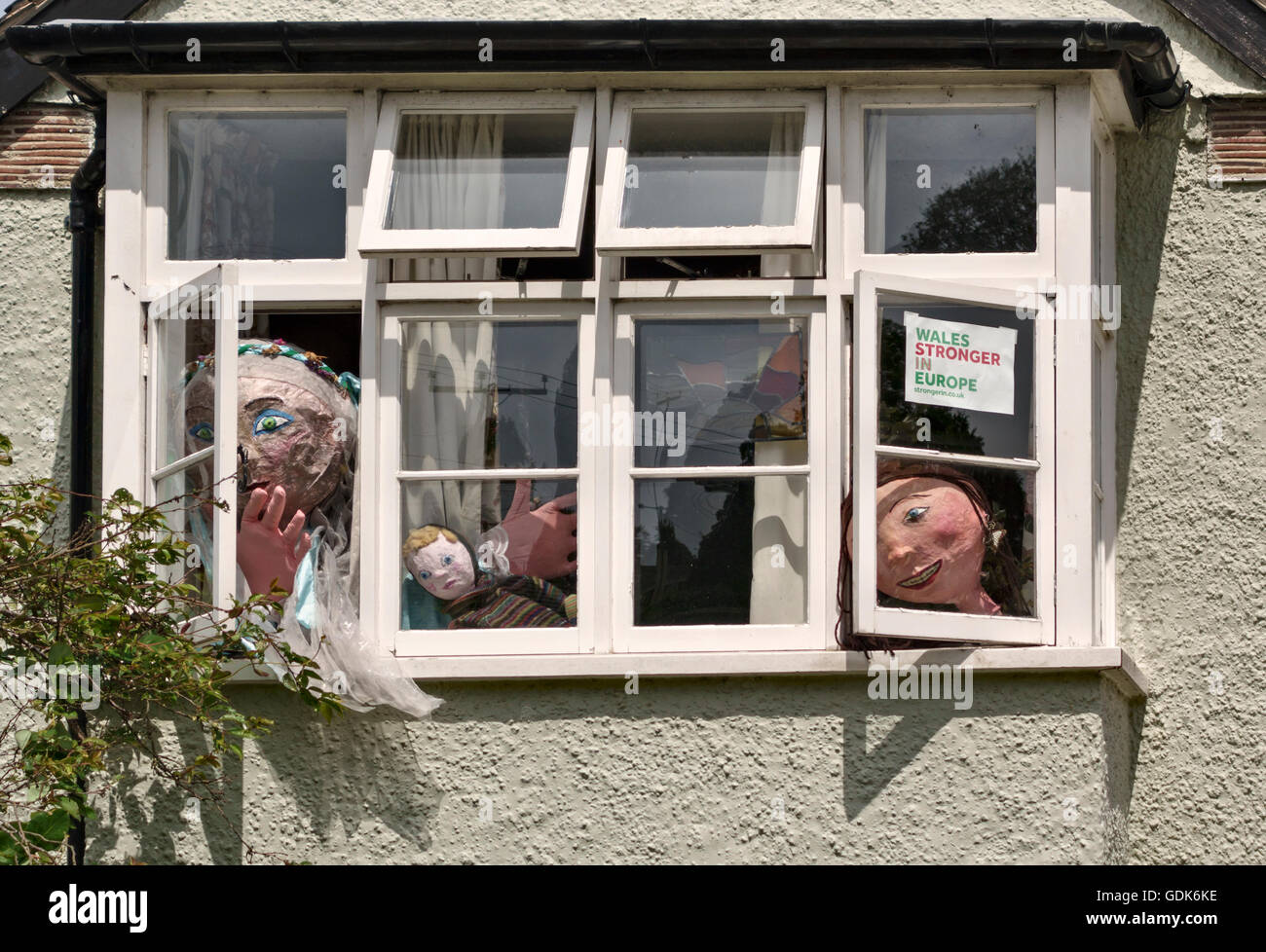 Presteigne, Powys, UK. Grotesque puppets looking out of a window, with a pro-EU poster - Stock Image