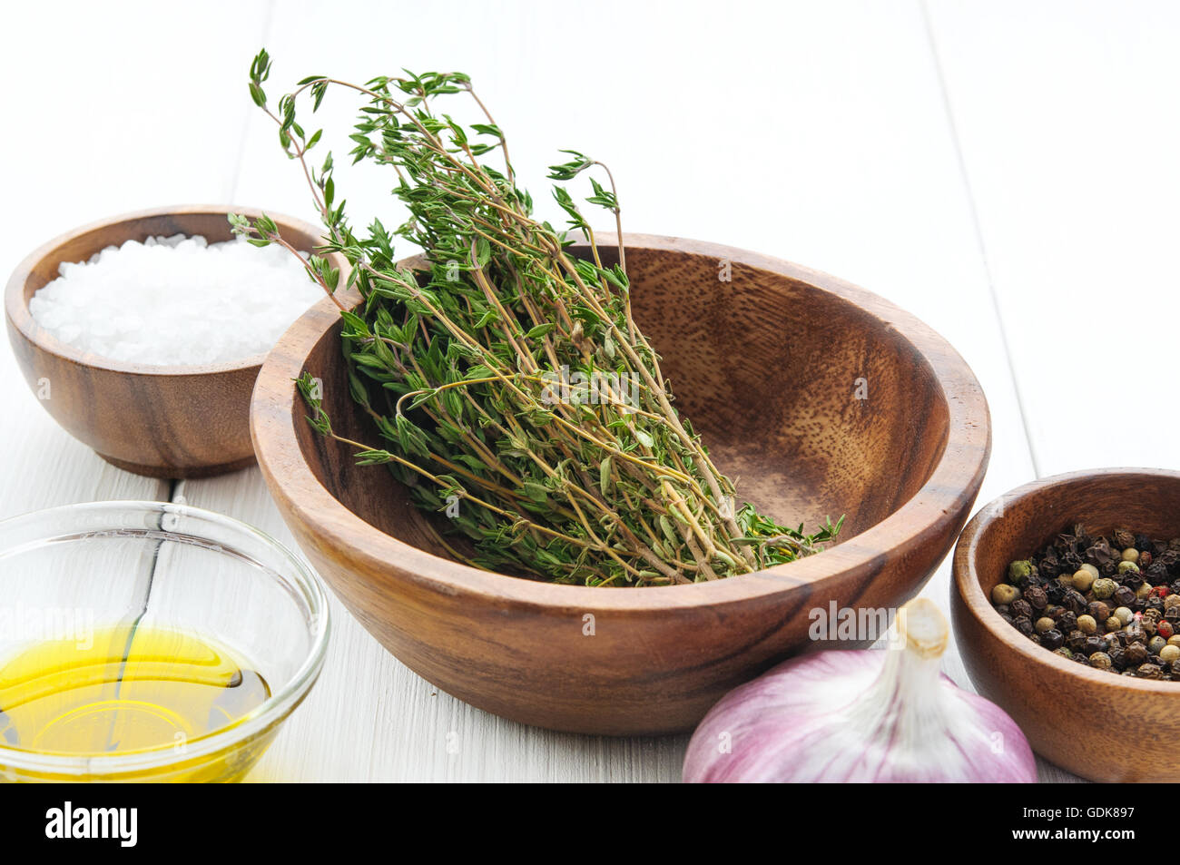 Cooking ingredients: thyme, salt, pepper, chili, garlic, olive oil in Stock  Photo - Alamy