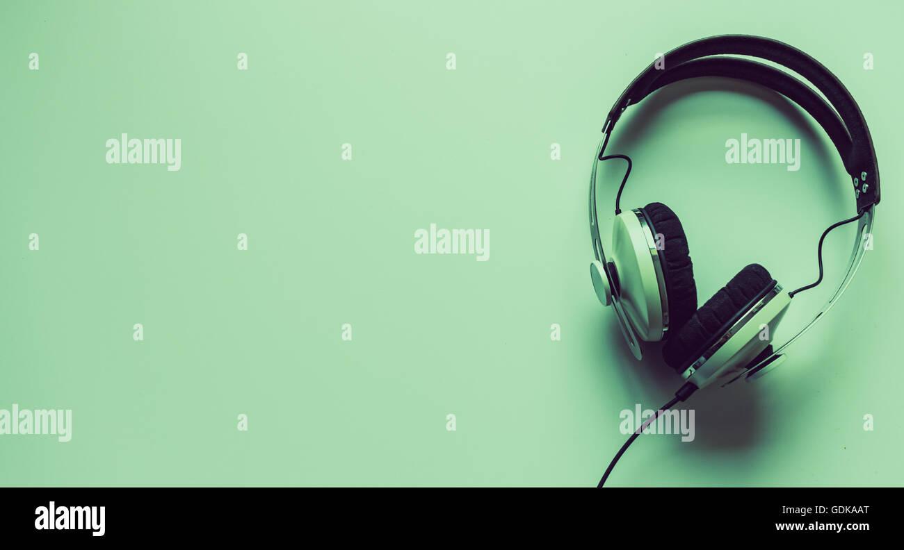 Single headphones on a table. - Stock Image