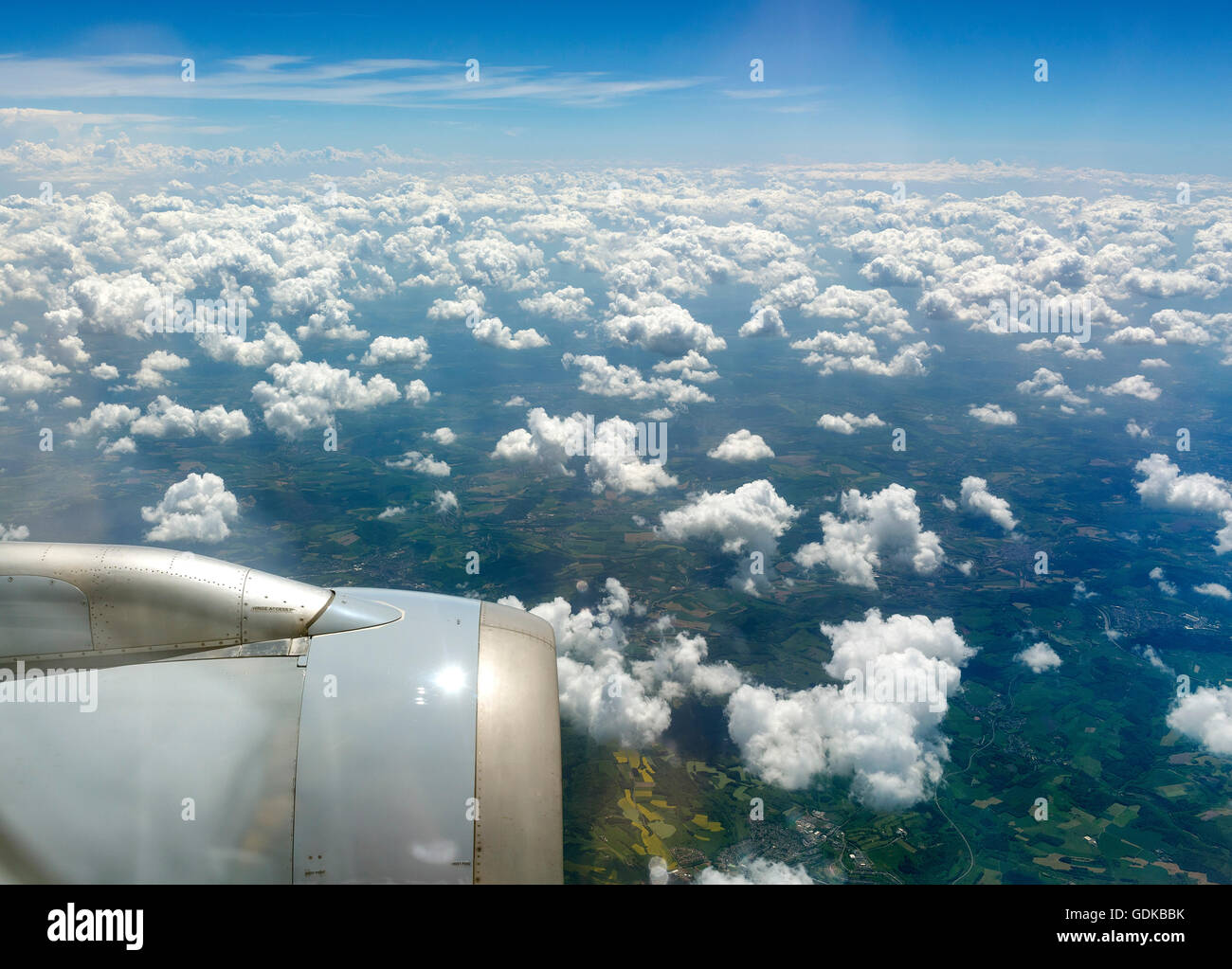 Aerial view, cumulus clouds over Rheinland-Pfalz, jet engines out,view from a Boing, Idar-Oberstein Rhineland-Palatinate - Stock Image
