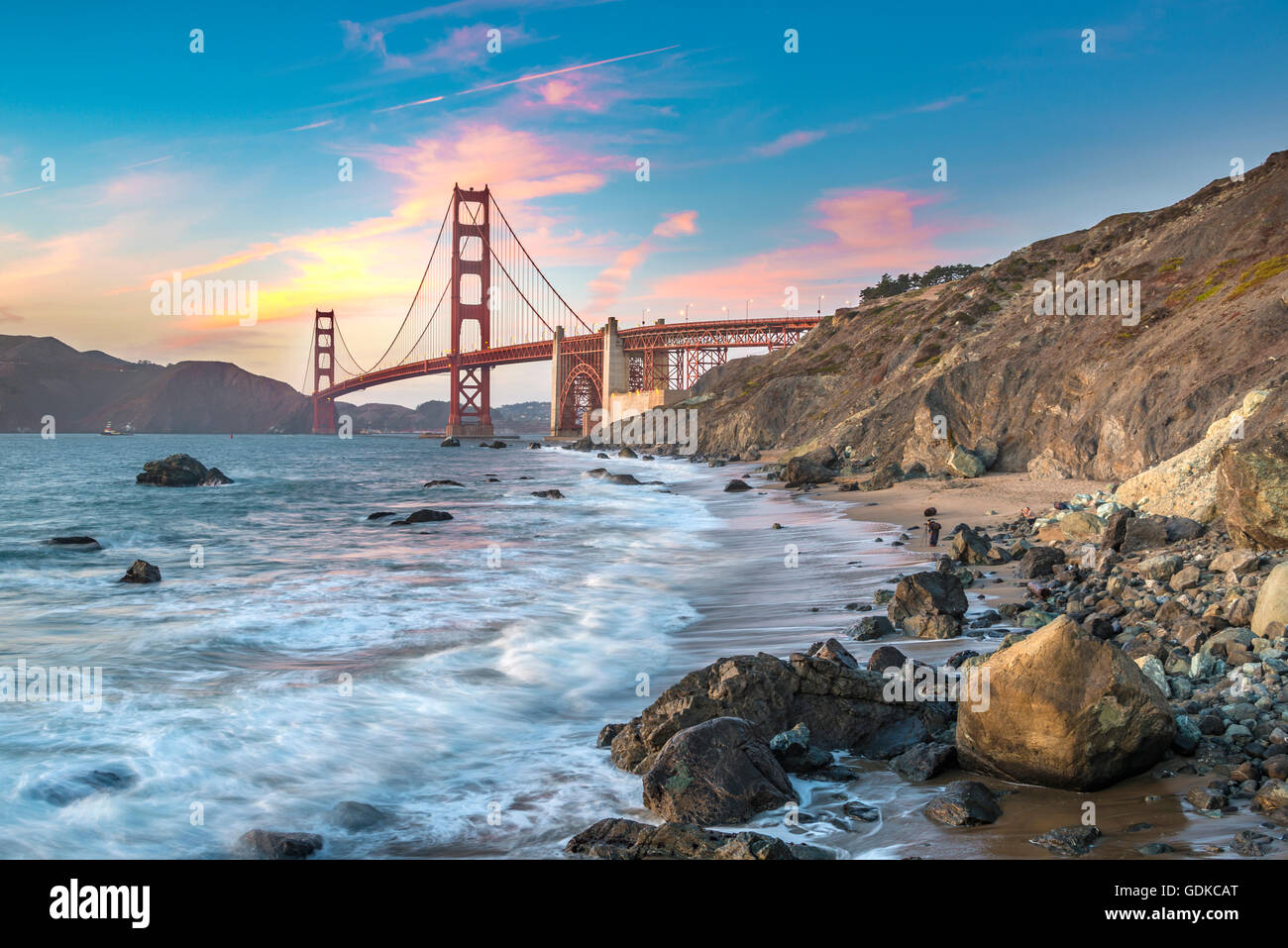 Golden Gate Bridge, evening light, Marshall's Beach, rocky coast, San Francisco, USA - Stock Image