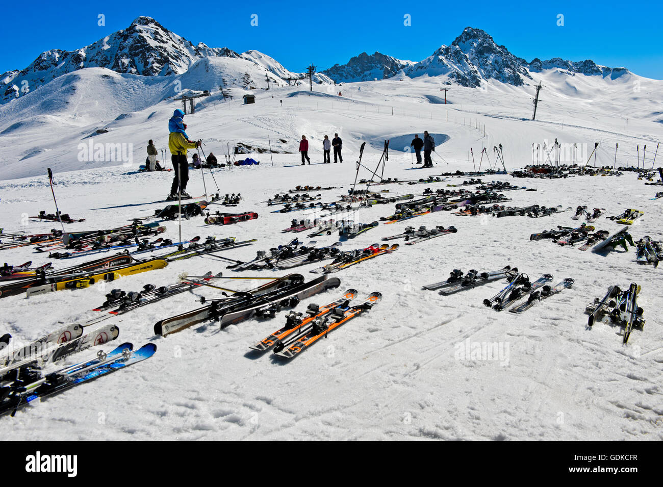 Pairs of skis lying on snow, Col du Joly, Les Contamines-Montjoie ski resort, Haute-Savoie, France - Stock Image