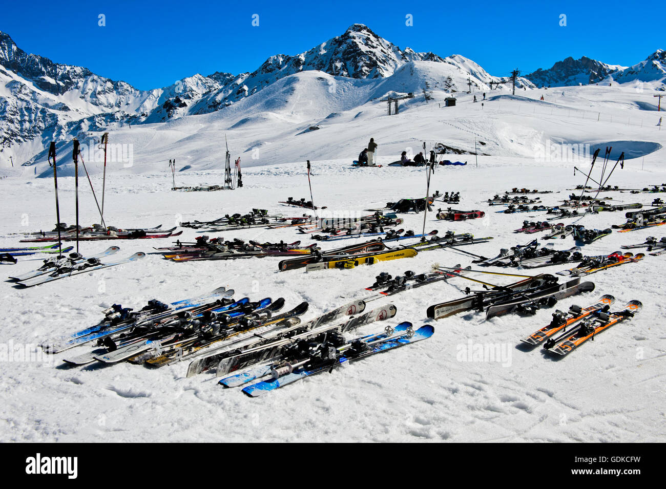 Pairs of skis lying on snow, Col du Joly, Les Contamines-Montjoie ski resort, Haute-Savoie, France - Stock Image