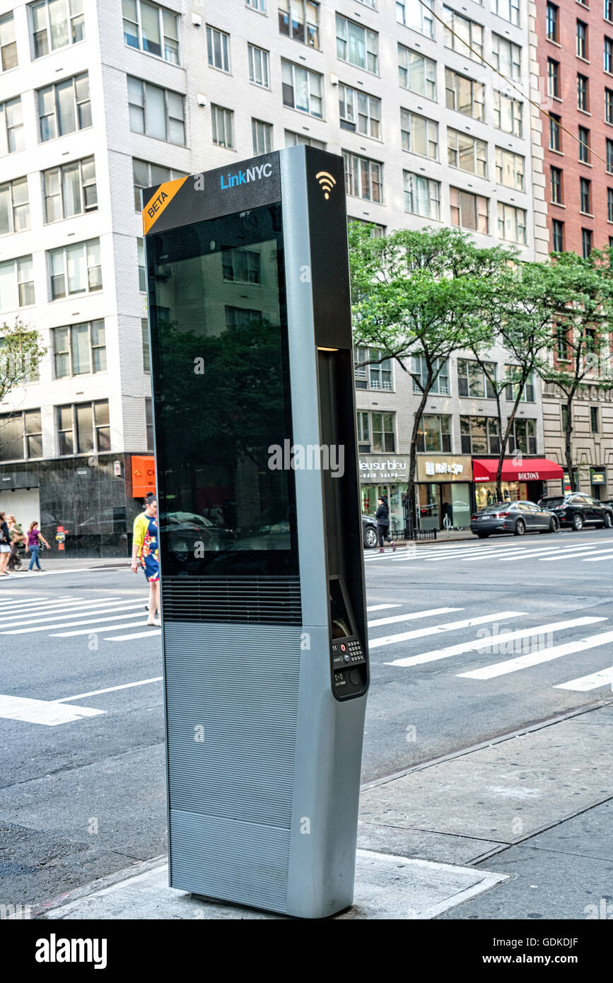 WiFi Kiosk on the Streets of the Upper East Side, New York City.  They are replacing old fashioned pay phone booths. - Stock Image