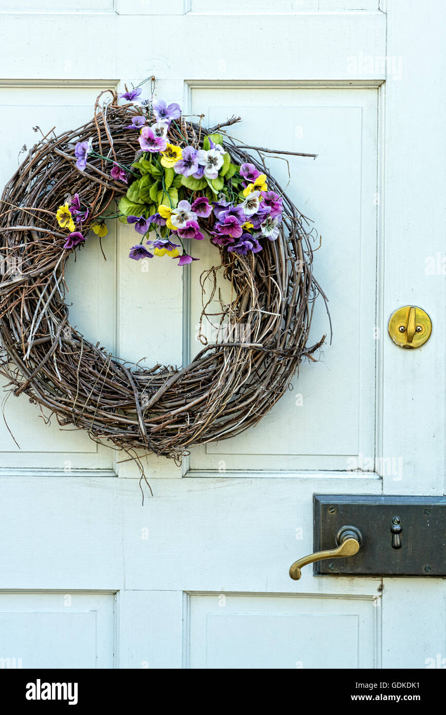 Decorative Twig and Flower Wreath on a Colonial Styled, White, Entry Door. Hamptons, Long Island, New York - Stock Image