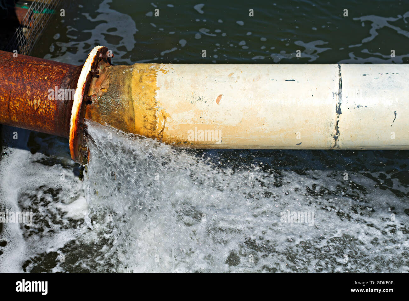 Water pouring from a fractured large diameter water pipe - Stock Image