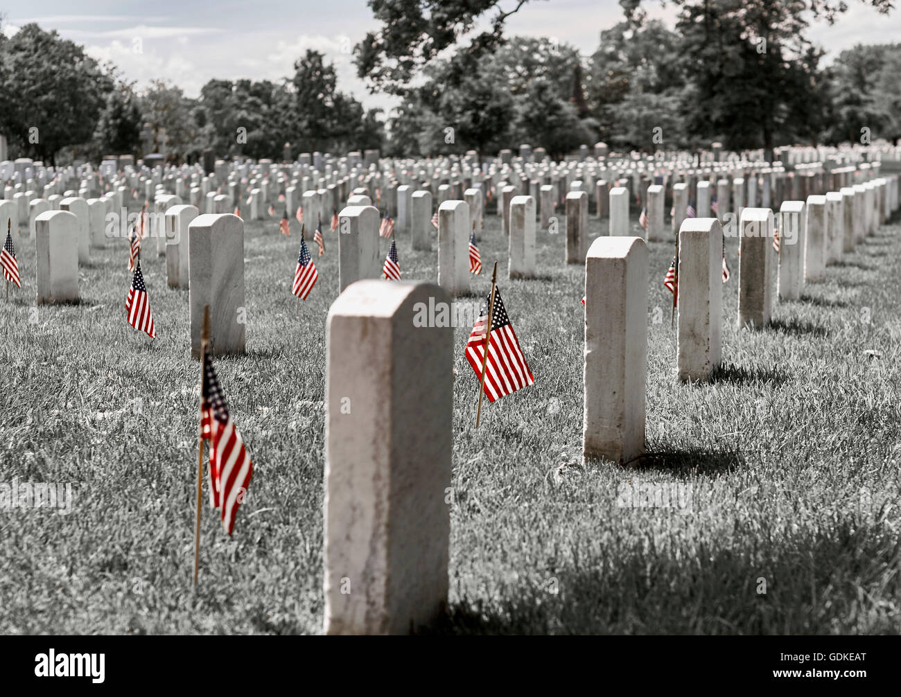 United States Flag on gravesites at Arlington National Cemetery on Memorial Day - Stock Image