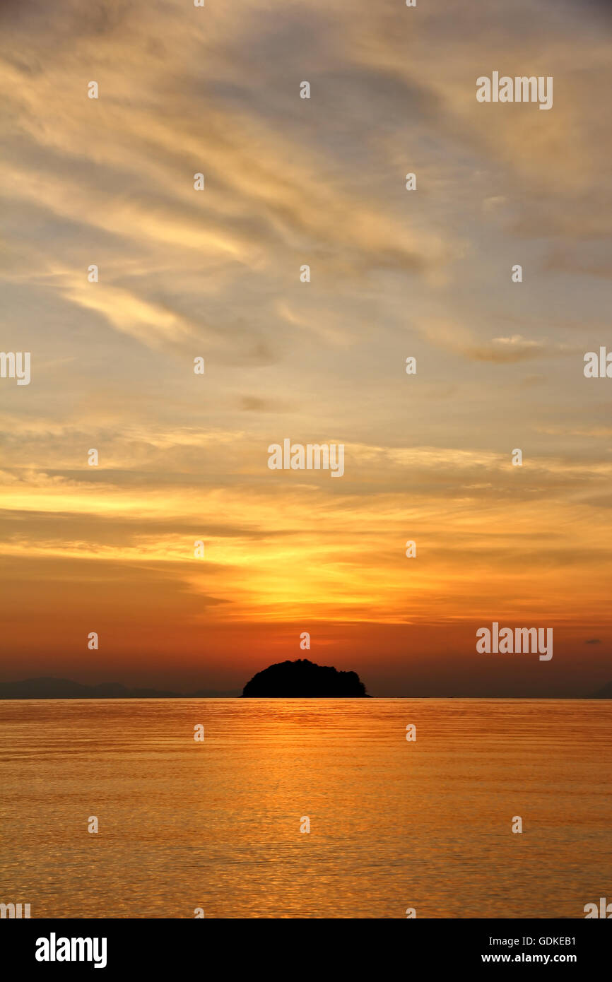 Partly cloudy in the evening sea. - Stock Image