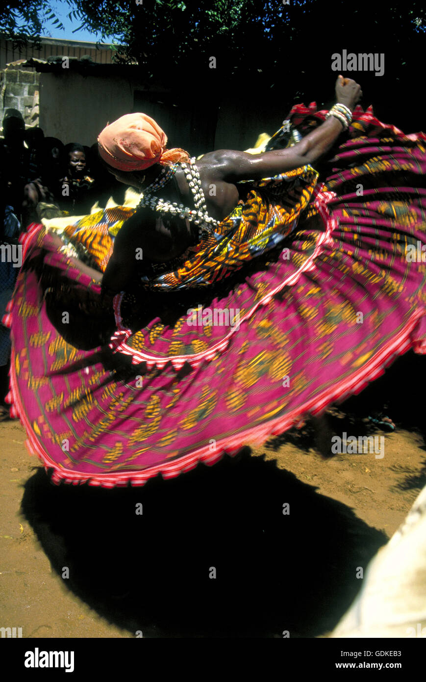 A voodoo priest in trance dances in whirling circles, as he