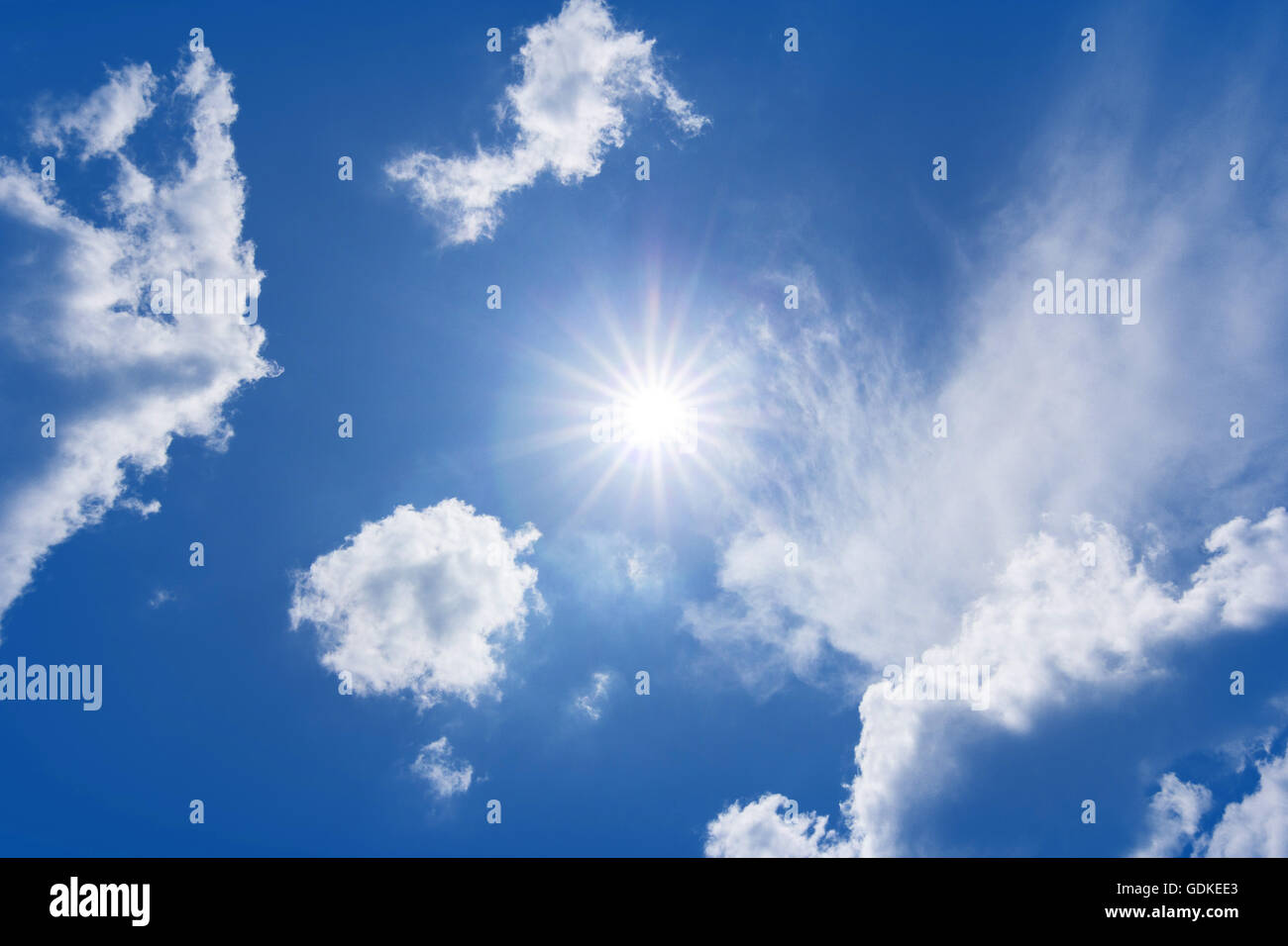 The sun shines bright in the daytime in summer. Blue sky and clouds. - Stock Image