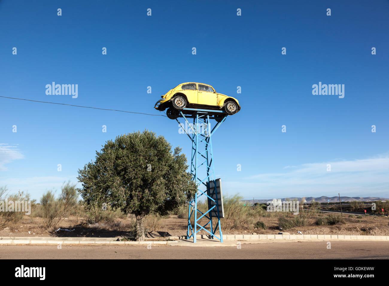 Old Volkswagen Beetle as Junkyard Sign - Stock Image