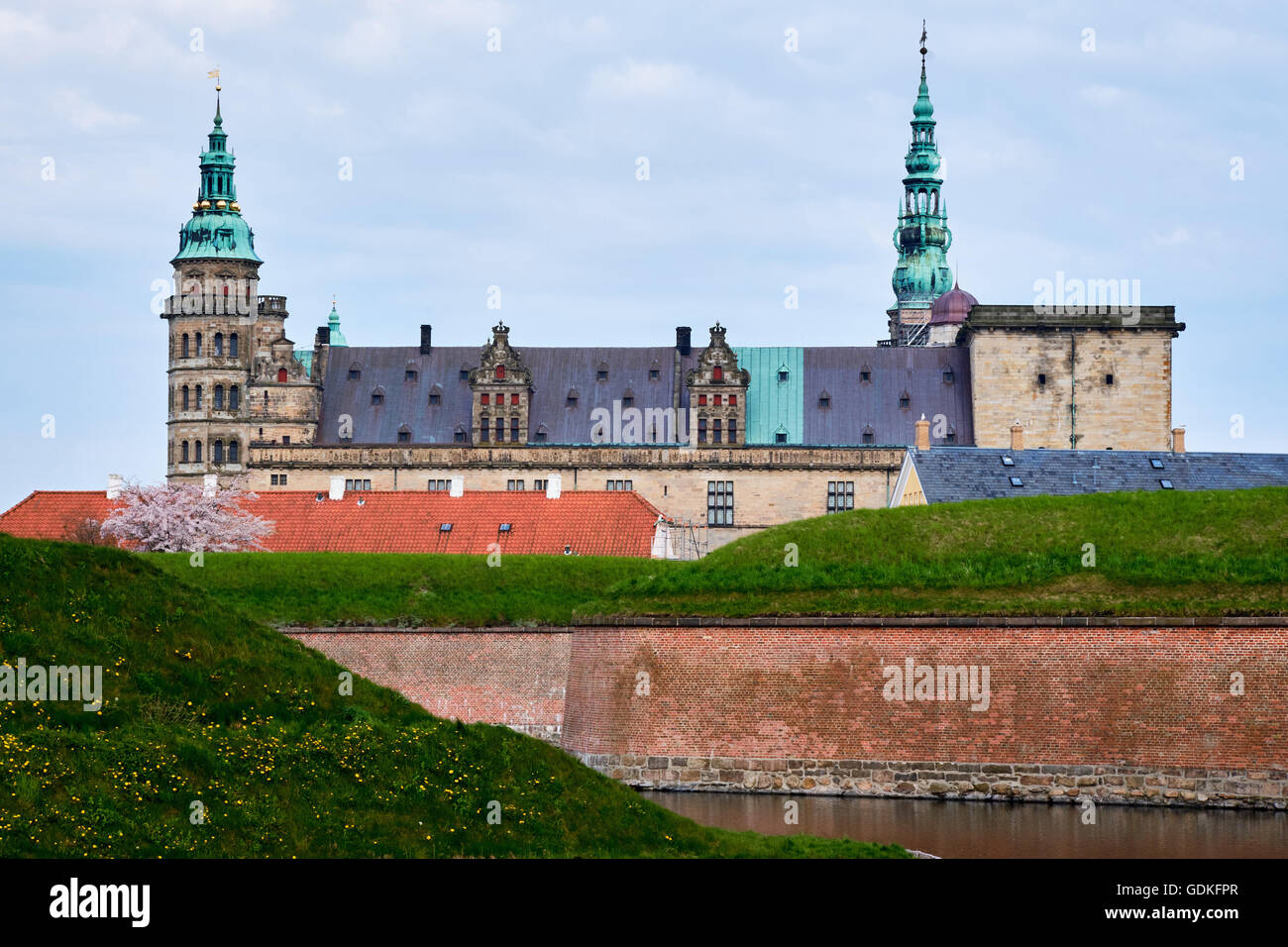 Elsinore castle in Denmark seen from the other side of the moat with vertical red brick walls - Stock Image