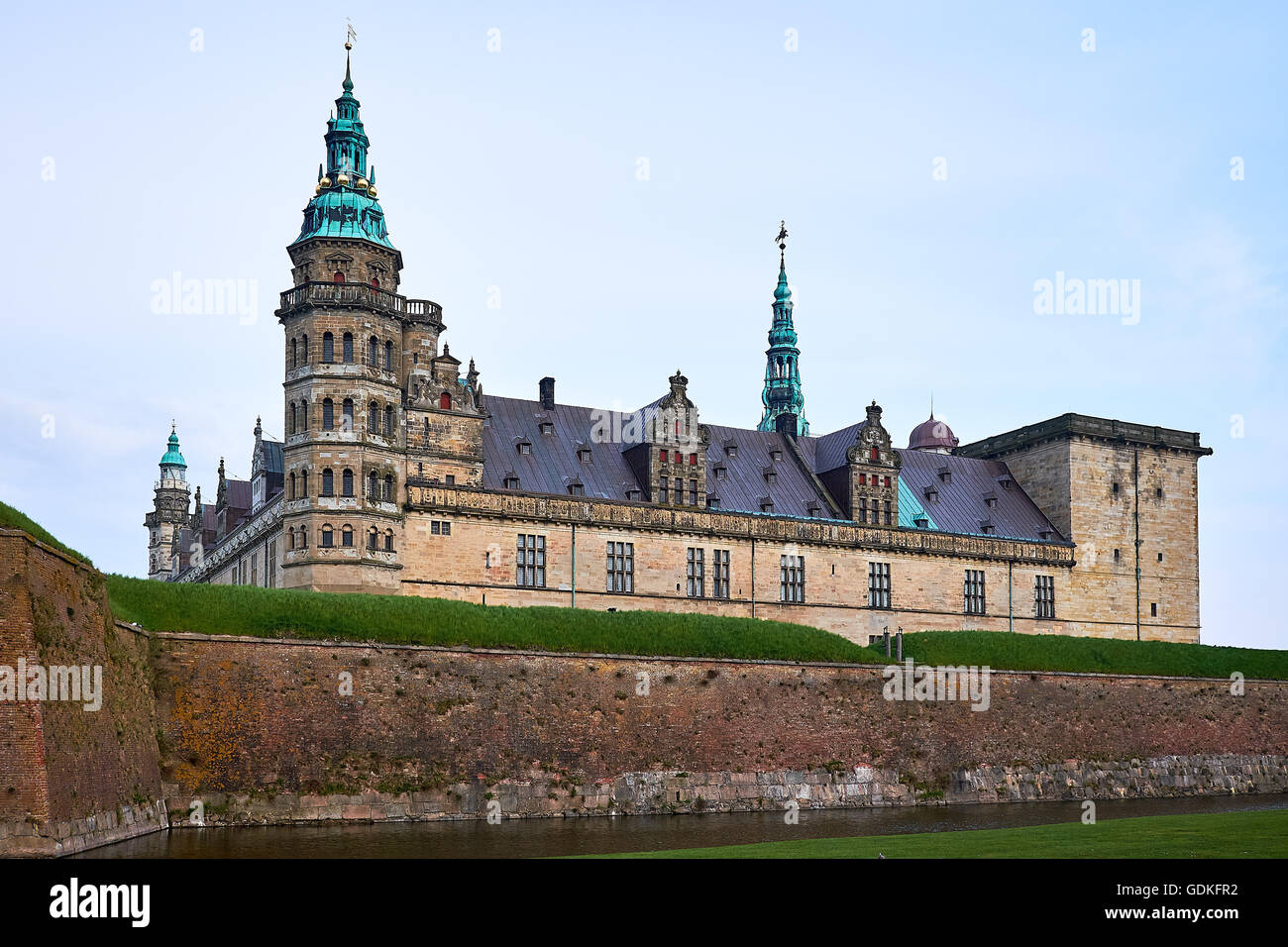 Elsinore castle the danish renaissance with green cobber spires and curlicues details, rising above the moat - Stock Image
