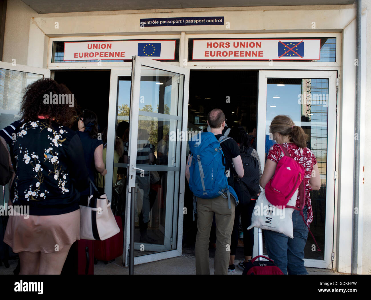 Waiting to go through French passport control, with one door for European Union and one for non EU passengers - Stock Image