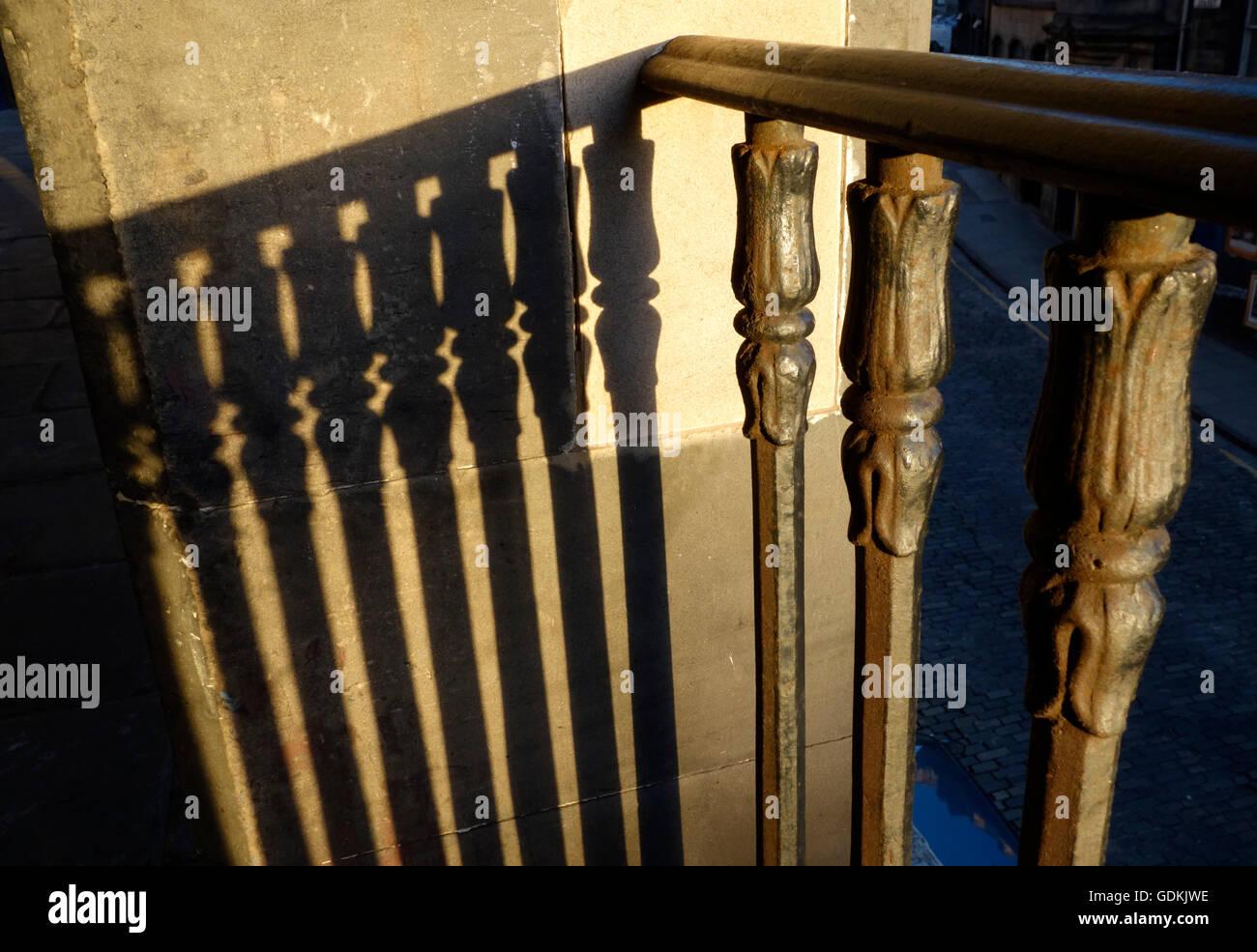 Shadows cast by iron railings above Victoria Street, Edinburgh - Stock Image
