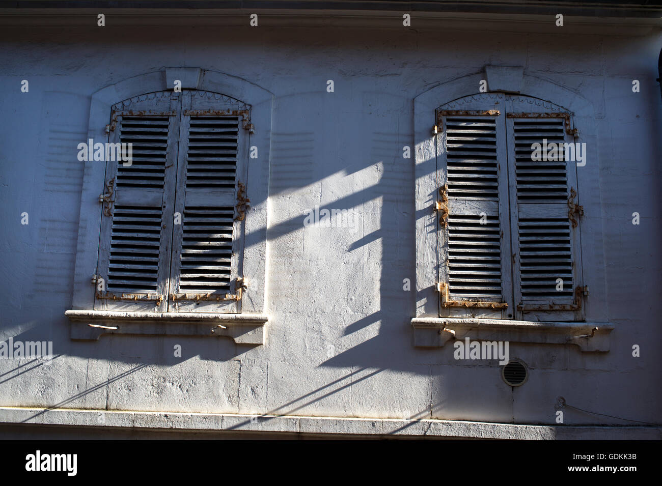 France. Arles. Closed shutters on an old house in disrepair. - Stock Image