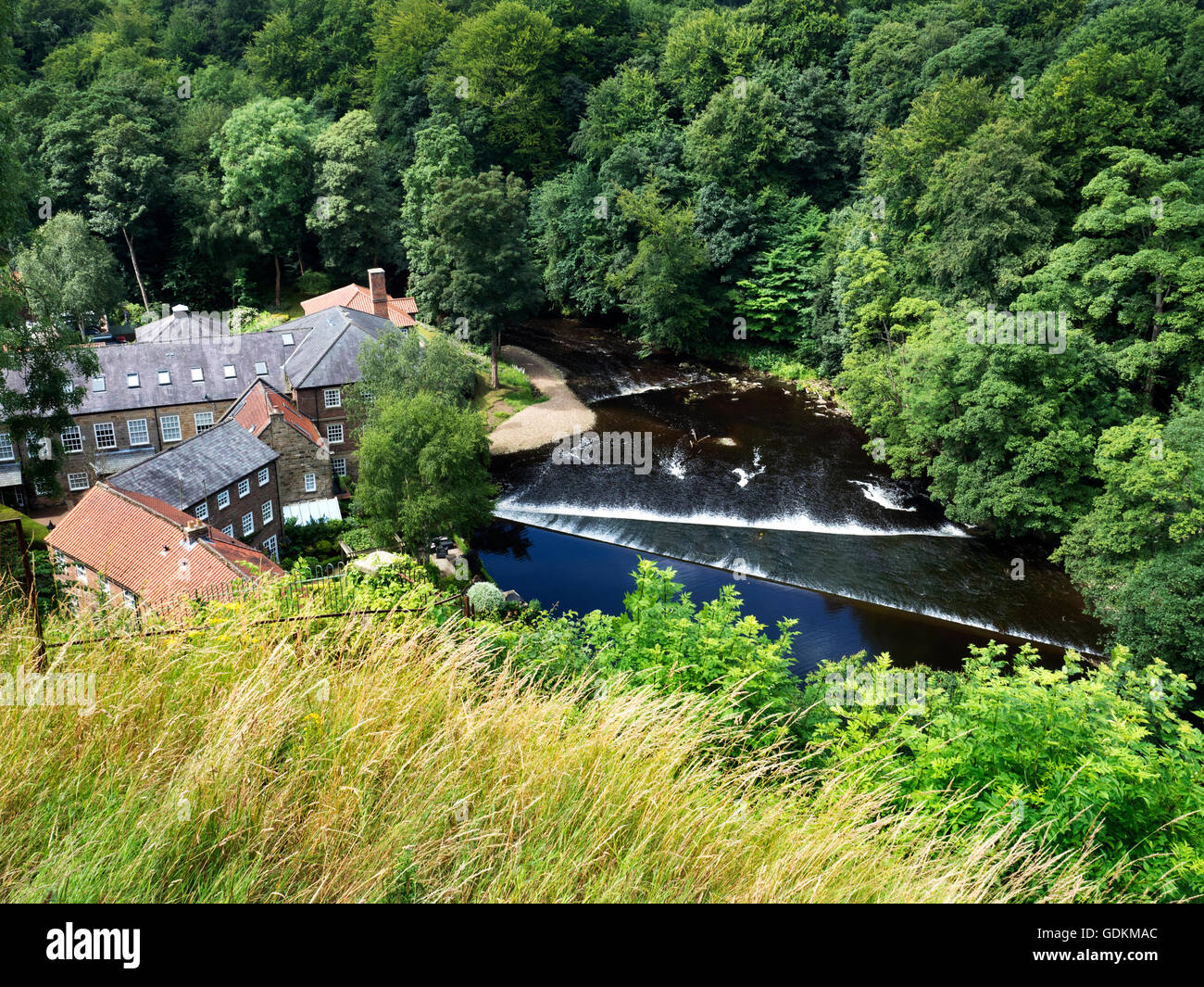 Castle Mills Former Linen Mill and Double Weir in the River Nidd from the Castle Grounds Knaresborough North Yorkshire - Stock Image