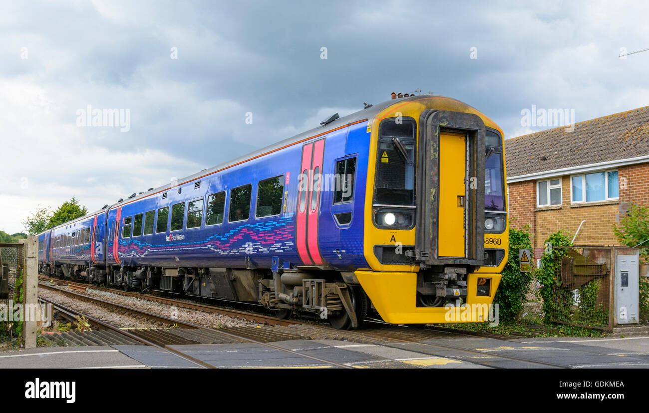 Great Western Railway train on a railway in the South of England, UK. - Stock Image