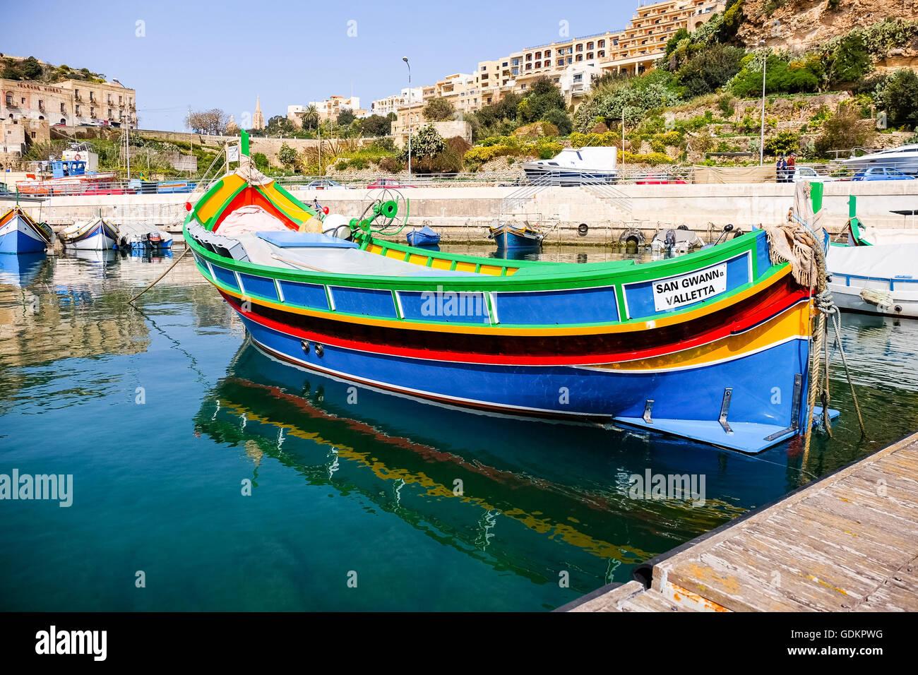 MGARR, GOZO ISLAND, MALTESE ISLANDS - APRIL 17, 2015:Marsaxlokk, a traditional maltese village  fishing boat, Mgarr - Stock Image