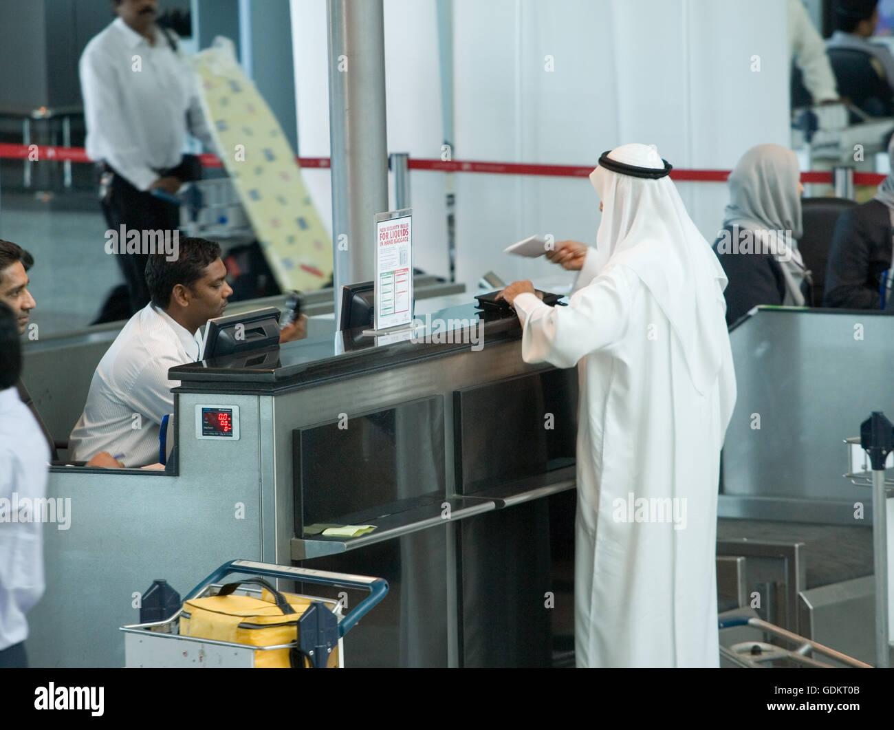 A man at a check-in counter, Sharjah International Airport
