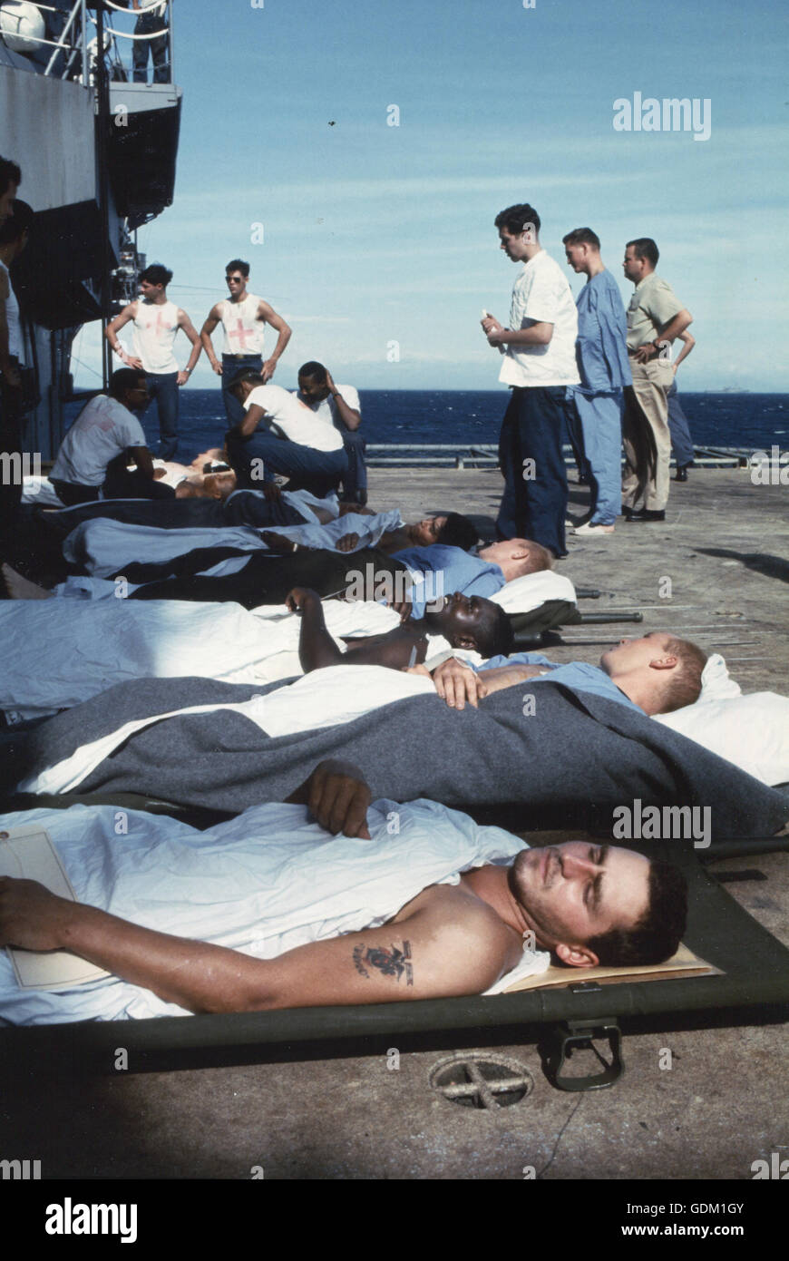 Medical evacuation patients on the deck of the amphibious assault ship USS TRIPOLI await transfer to the 22nd Casualty - Stock Image