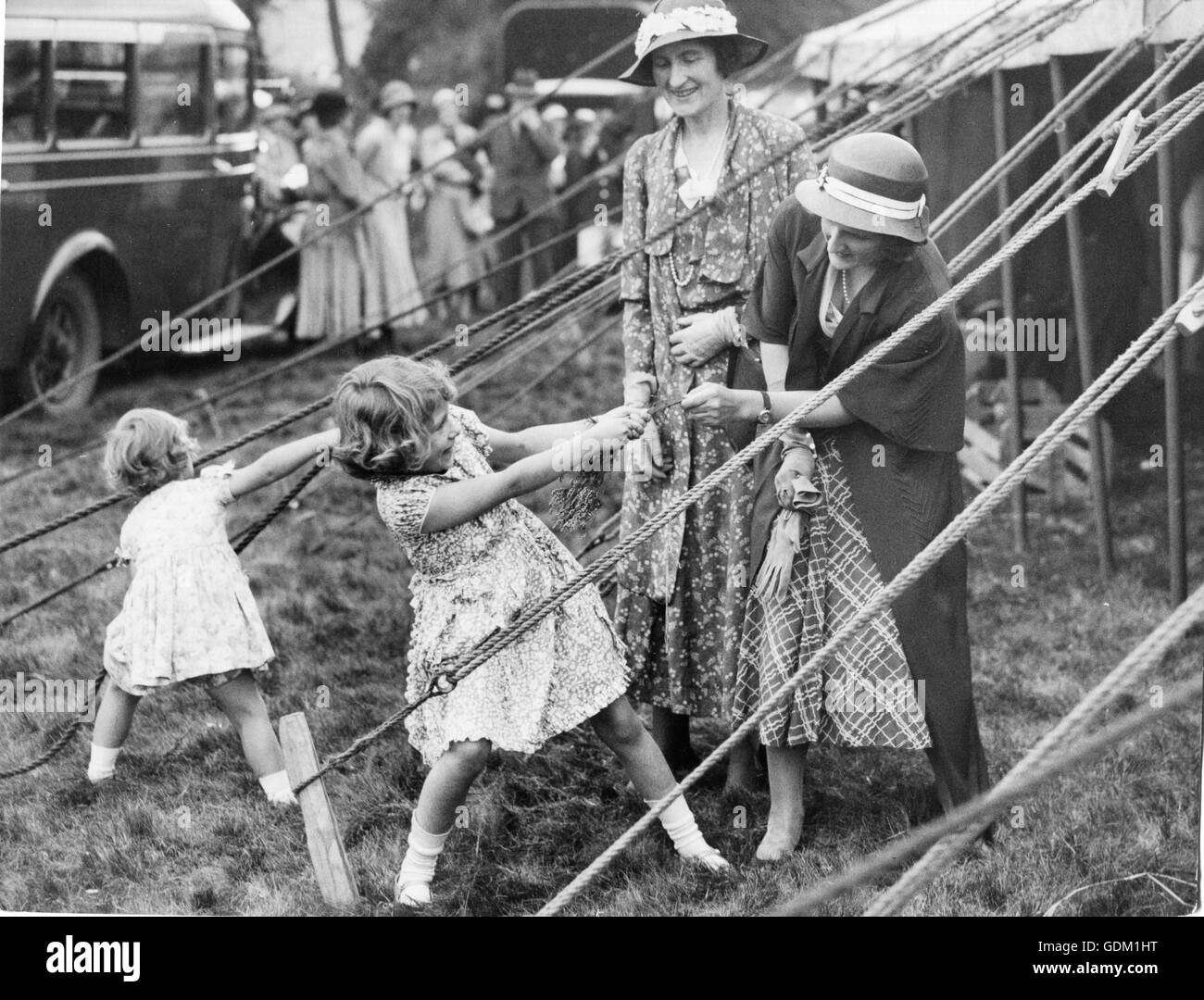 This charming snapshot, taken at the Abergeldie Castle (Scotland) Fete, behind the marquee in which the two little - Stock Image