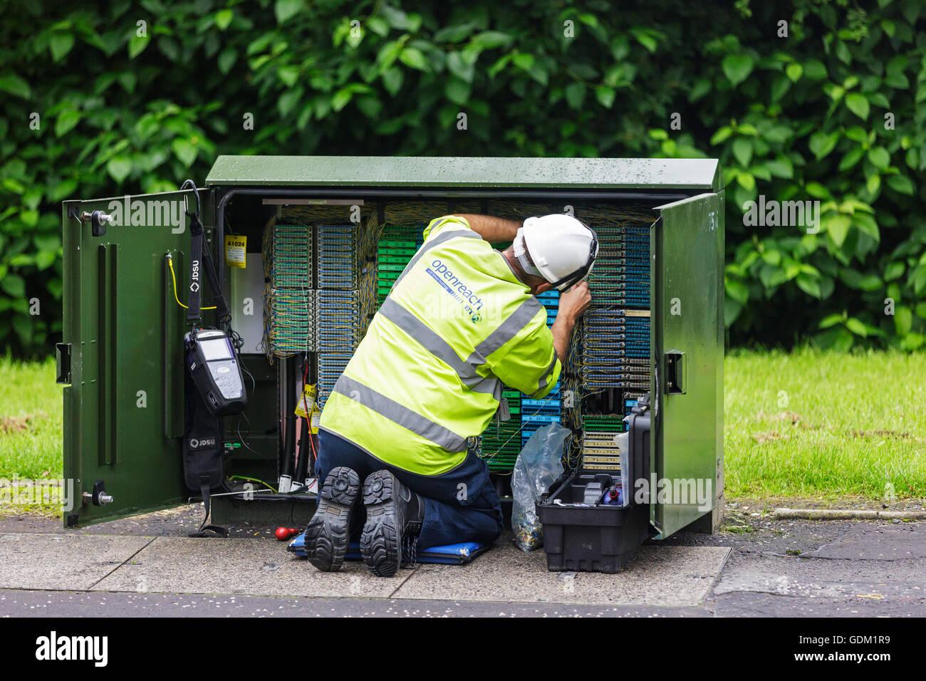 Openreach telephone and internet technician repairing a switch box, Scotland, UK - Stock Image