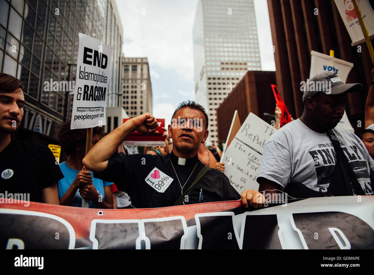 Cleveland, Ohio, USA. 18th July, 2016. A Catholic priest is seen during a anti Trump Rally in Cleveland, Ohio July, - Stock Image