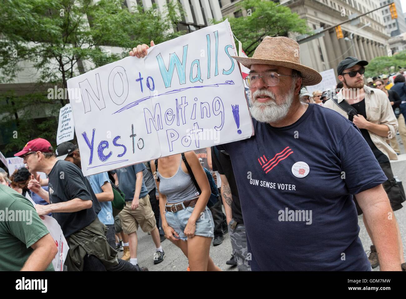 Cleveland, Ohio, USA. 18th July, 2016. Anti-Trump protesters march through downtown near the Republican National - Stock Image
