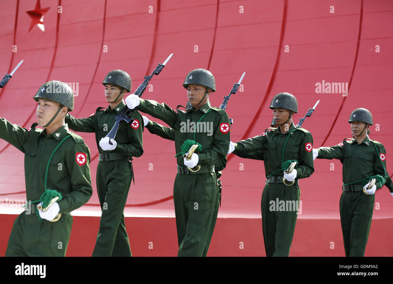 Yangon, Myanmar. 19th July, 2016. Honor guards march during a ceremony to mark the 69th Martyrs' Day in Yangon, - Stock Image